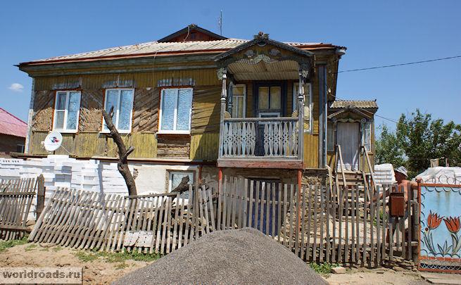 Дом с балкончиком